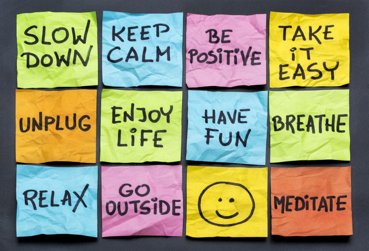 graphic with boxes that read: slow down, keep calm, be positive, take it easy, unplug, enjoy life, have fun, breathe, relax, go outside, smiley face, meditate